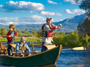 Fly Fishing in The Little Nell's hand-crafted wooden boat on the Roaring Fork River.