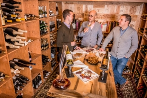 The Little Nell wine team gathers in the new wine cellar for a tasting.  Photo: C2 Photography